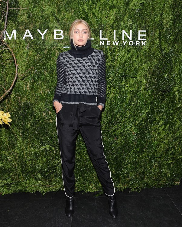 The 19-year-old revives last year's sport-luxe trend with the addition of NYFW's sartorial obsession, the roll-neck jumper.
