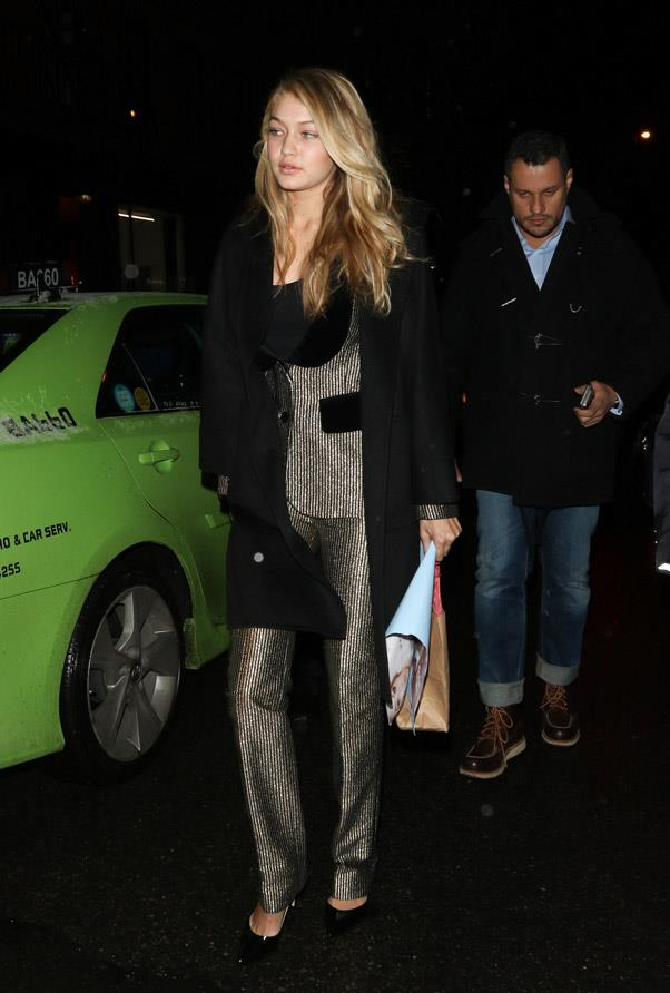 Gigi's striking ensemble is every part fashion muse; being reminiscent of Diane Keaton's get-up in <em>Annie Hall</em> and the iconic pant-suits of Lauren Hutton in the '70s.
