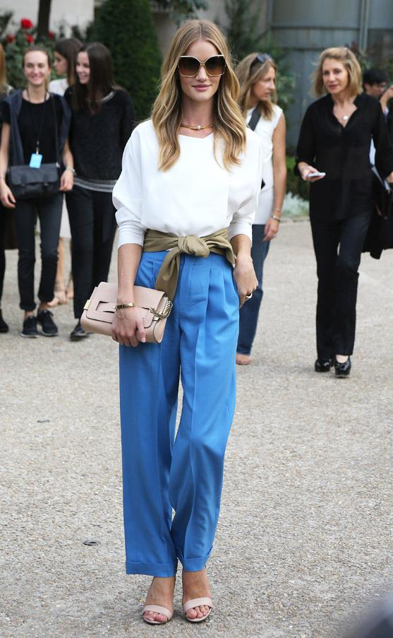 While pulling off the wide-legged pant can be a difficult feat, Rosie Huntington-Whiteley teaches us that nude heels can lend height, while the waist-wrap and oversized sunnies balance out the heaviness of the pants.