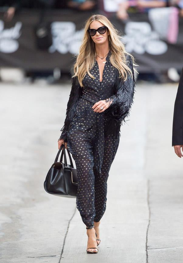 Elle Macpherson is a true testament to innate style at any age! The former supermodel kills it in a '70s essential – the jumpsuit – along with oversized shades and a feathered coat.
