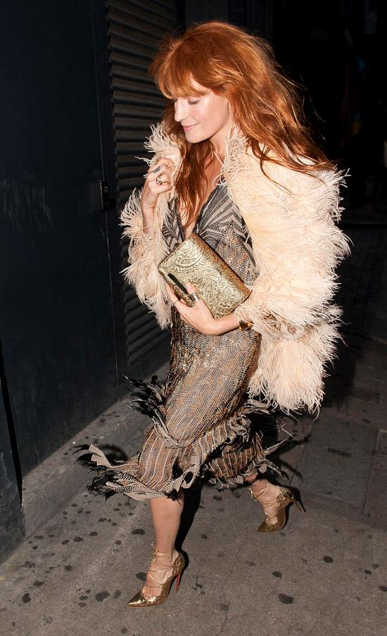 Singer Florence Welch has always been a bohemian vision with her copper locks and leggy physique, but she truly elevates her aesthetic to a '70s dream with this slip dress and feathered coat.