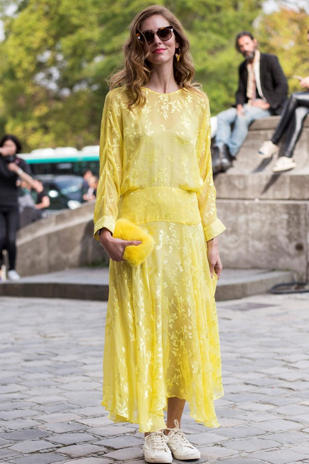 Wearing an ultra-feminine dress? Sneakers will tone down the girly aesthetic....