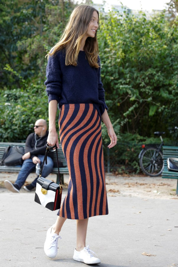 We love the contrast of casual sneakers with ladylike midi hemlines.