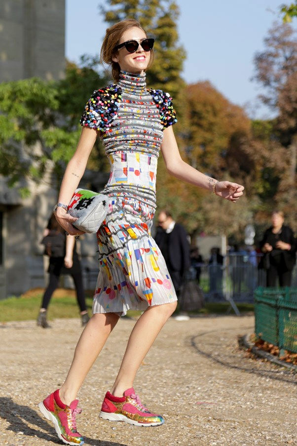 Dress down your favourite cocktail dress (hello, Chanel!) with a pair of sneakers for a daytime-appropriate look.