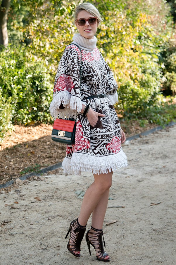 Blogger Sofie Valkiers in Emilio Pucci poncho and shoes, Furla sunglasses and Elie Saab bag.