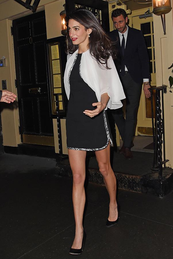 Case in point: the perfect date night ensemble, Amal shows off her best assets, her never-ending legs—in a Giambattista Valli dress straight from their Spring 2015 collection.