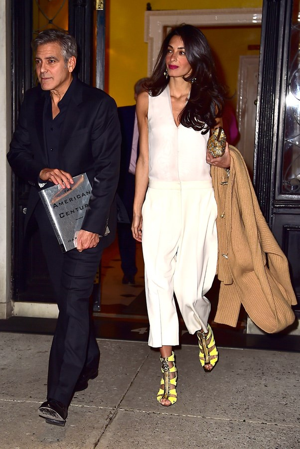 Nailing early-Spring dressing, Amal embraces the Spring 2015 culottes trend in a luxurious, crisp, white jumpsuit and Versace heels for the perfect pop of colour.