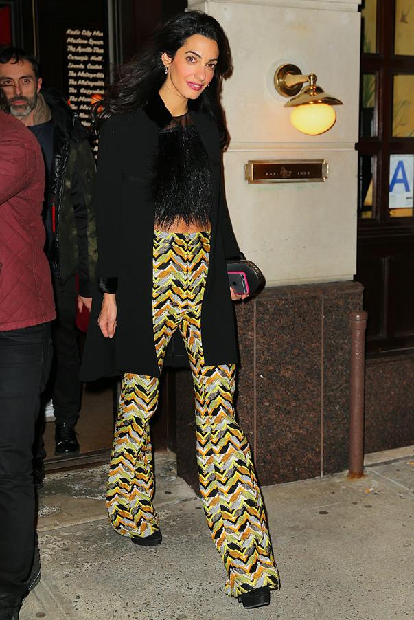 Showing her playful side, Amal matches a pair of geometric-printed flares from <strong>Giambattista Valli</strong> with a textured crop while out to dinner at Monkey Bar in New York City.