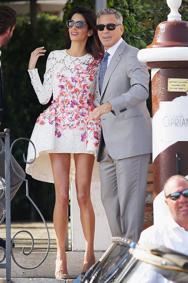 Competing for the most stunning newlywed couple, the barrister opts for a structured, floral and lace embroidery Giambattista Valli mini dress, again letting her enviable pins do all the talking.