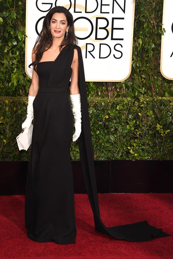If anybody can bring back the 'opera glove' it would be Amal. Clooney looks stunning in a classic, black gown while supporting her husband George Clooney at the 2015 Golden Globe Awards.