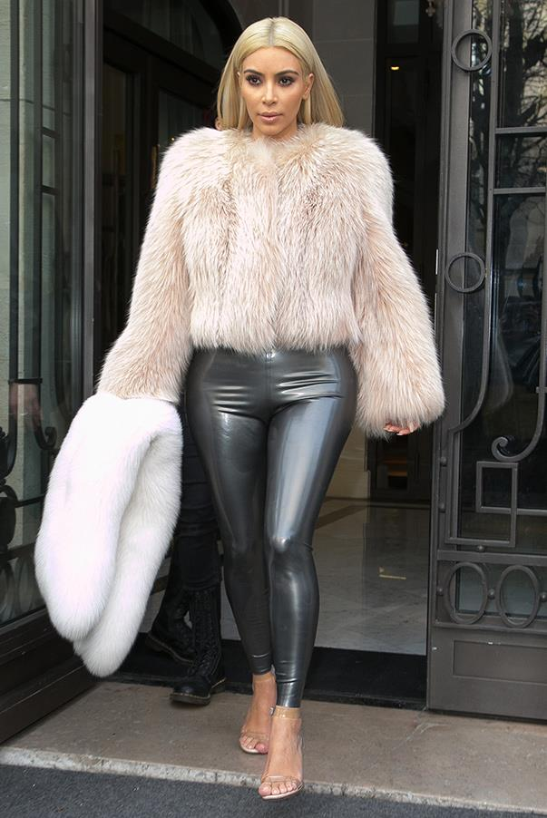 Kim opts for a fur coat and wet-look pants while in Paris on the 7th of March.
