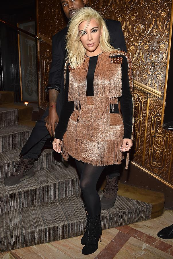 Tassels galore. Kim and Kanye attend the Balmain after show dinner during Paris Fashion Week (5th March).