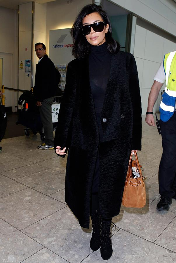 Proving that all-black is the only way to travel – Kim arriving at Heathrow Airport enroute to Paris. February 25th 2015.