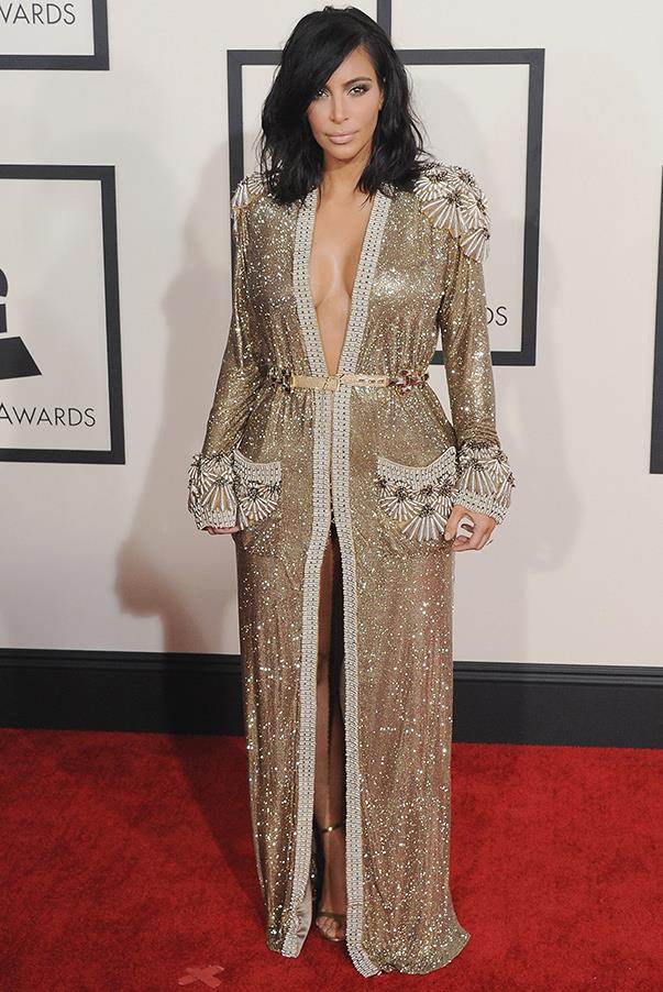 Kim teams a glitzy, 30s inspired dress with bead detailing on the pockets, sleeves and shoulders for 57th GRAMMY Awards on the 8th of February 2015 in Los Angeles.