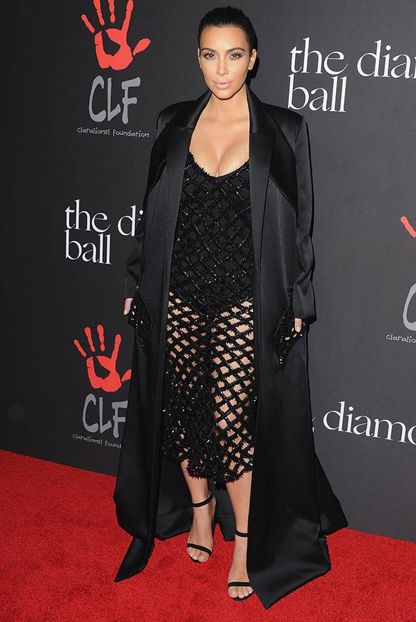 Kim wears another all-black look while on the red carpet for Rihanna's First Annual Diamond Call at The Vineyard in Beverly Hills, California (11th Dec).
