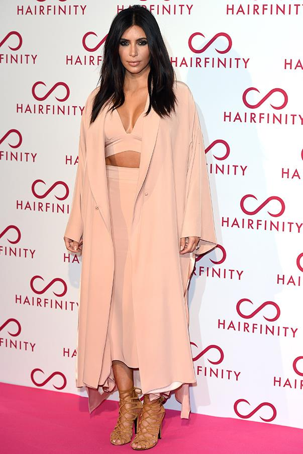 Pretty in pastel, Kim rocks the duster coat trend while attending the Hairfinity UK Launch Party in London, England ont the 8th Nov.