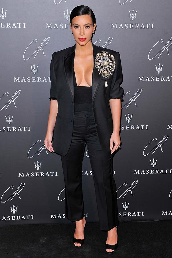 Never the one to shy away from drama, Kim teams a black pant suit with an ornate, elaborate brooch at the CR Fashion Book Issue no.5 Hosted by Carine Roitfeld and Stephen Gan on September 30th.