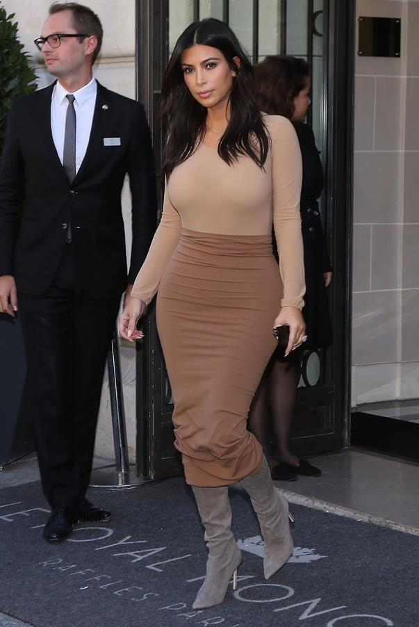 Kim Kardashian wears a tri-tonal nude ensemble leaving the Art District in Paris on September 27th 2014 in Paris.