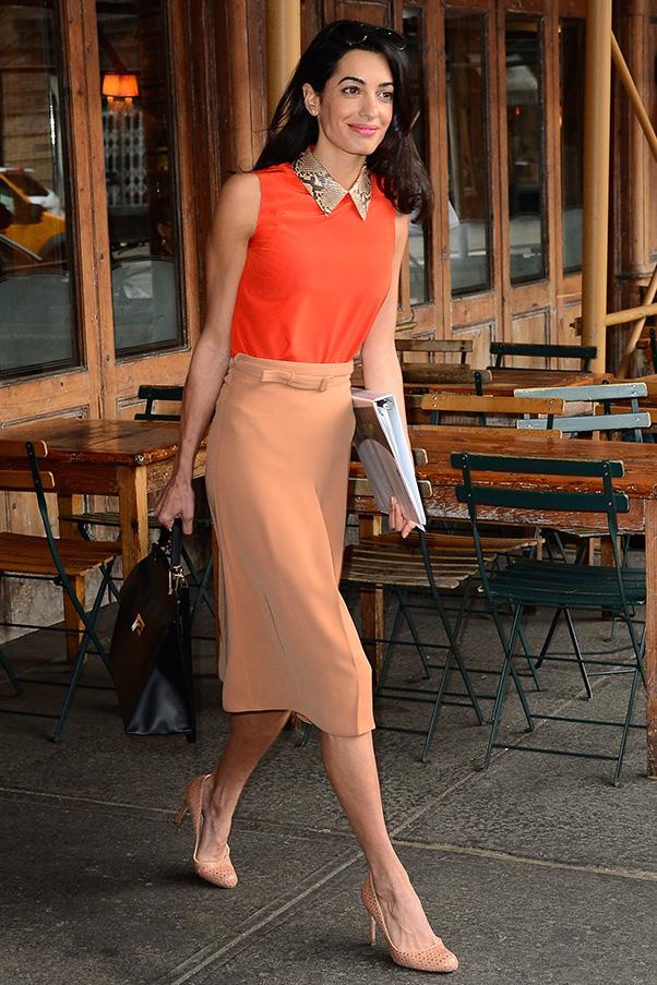 Proving she's not afraid of colour, Clooney looks bold in orange hues while out at lunch in New York.