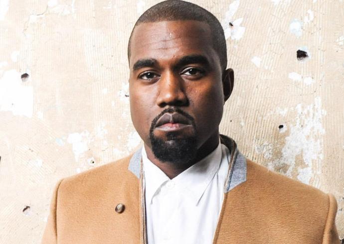 Kanye West wears a camel coat
