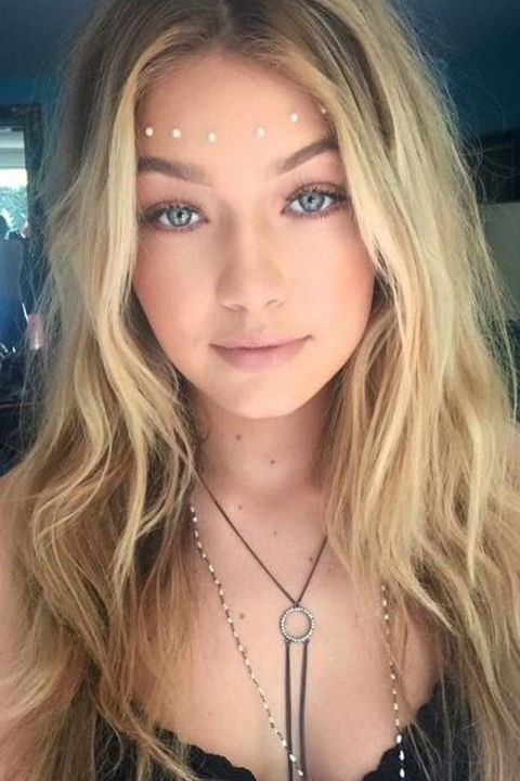 """<strong>GIGI HADID</strong> <br>Hadid nailed the boho goddess look with soft waves, glowing skin, face jewels and a Guess body chain. <br><a href=""""https://instagram.com/p/1YdVuEDCWp/"""">@gigihadid</a>"""