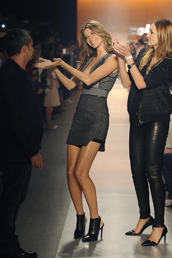 <br><strong>Colcci</strong> <br><strong><em>2013</em></strong> <br>The Brazilian model walks for Colcci again at Sao Paulo Fashion Week, saluting her friends: the collection's designers.