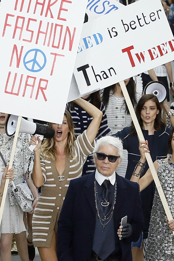 "<br><strong>Chanel</strong> <br><strong><em>2014</em></strong> <br>Gisele followed friend and icon Karl Lagerfeld to Paris for the Chanel spring/summer 2015 ""protest"" show."