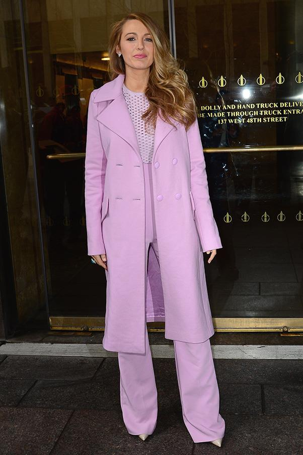 Another departure, another outfit change: leaving the radio appearance in a monochrome pink suit and trench.