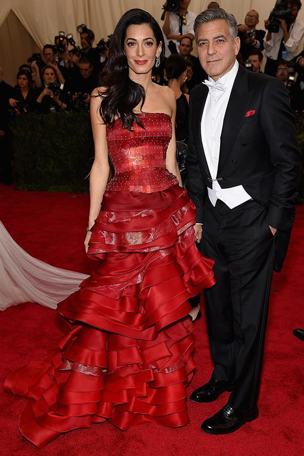 Wearing a tiered masterpiece by John Galliano, Amal and George looked stunning at the Met Gala red carpet.
