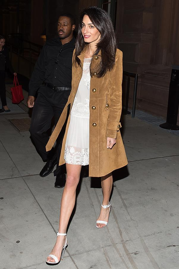 Looking on trend and elegant, Amal champions a '70s-inspired suede coat with a delicate, sheer white dress and classic heels.