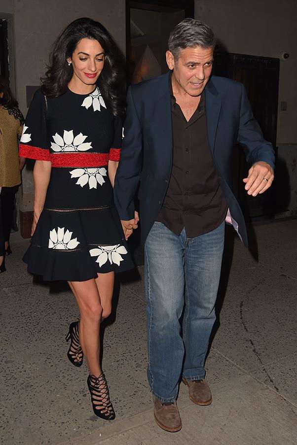 Amal wears a bold, printed dress with cheeky, cut-out detailing and sexy, lace up heels for a date night at Caravaggio on the Upper East Side.