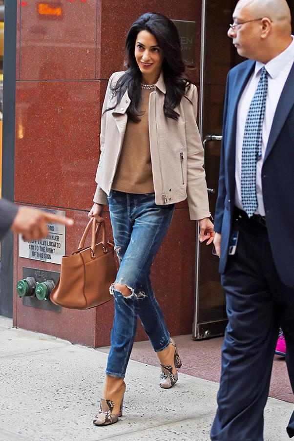 Chic and relaxed, Amal puts her twist on off-duty dressing, mixing ripped jeans with a structured handbag and boxy leather jacket.