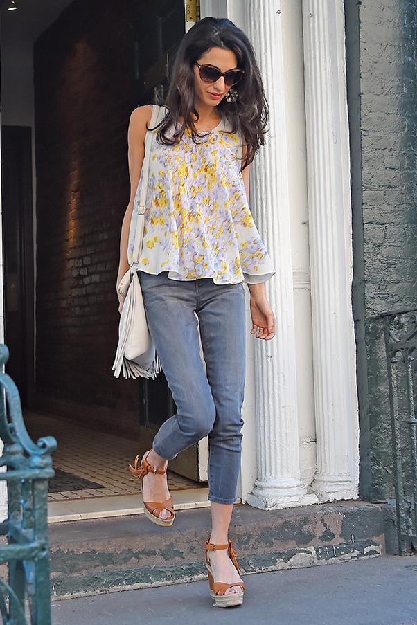 The perfect summer outfit. Note how the blue in her breezy, floral top matches her jeans and her mani/pedi.