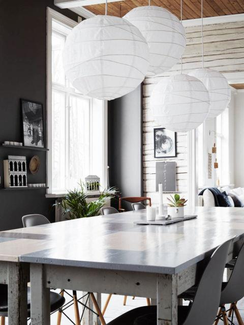 """<strong>BIG PAPER LANTERNS</strong> <br><br>There's an ethereal feel to these giant paper lanterns, a sideways take on a traditional chandelier. In calligrapher <strong><a href=""""http://go.redirectingat.com/?id=74968X1525079&site=harpersbazaar.com&xs=1&isjs=1&url=http%3A%2F%2Fwww.ylvaskarp.se%2Fen%2F&xguid=b758a018924f818bb1da76acdd51ba42&xuuid=a9130e925d409582e383bd6be491106a&xsessid=59cd1f88015131a714ec018166b9c899&xcreo=0&xed=0&sref=http%3A%2F%2Fwww.harpersbazaar.com%2Fculture%2Finteriors-entertaining%2Fg5686%2Fscandinavian-trends%2F%3Fslide%3D8&xtz=-600"""">Ylva Skarp's</a> </strong>home, as seen at <strong><a href=""""http://nordicdesign.ca/calligrapher-ylva-skarps-home/"""">Nordic Design</a></strong>, four huge lanterns hang over her kitchen table, creating a whimsical effect. <br><br><strong>Photo credit</strong>: Kristofer Johnsso"""