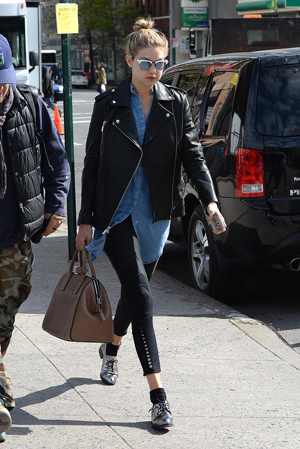 Despite sporting a classic model-off-duty look, Gigi elevates the leather jacket, oversized sunnies and black pants combination with an oversized denim shirt, and metallic brogues. Extra points for the unconventional sock length.