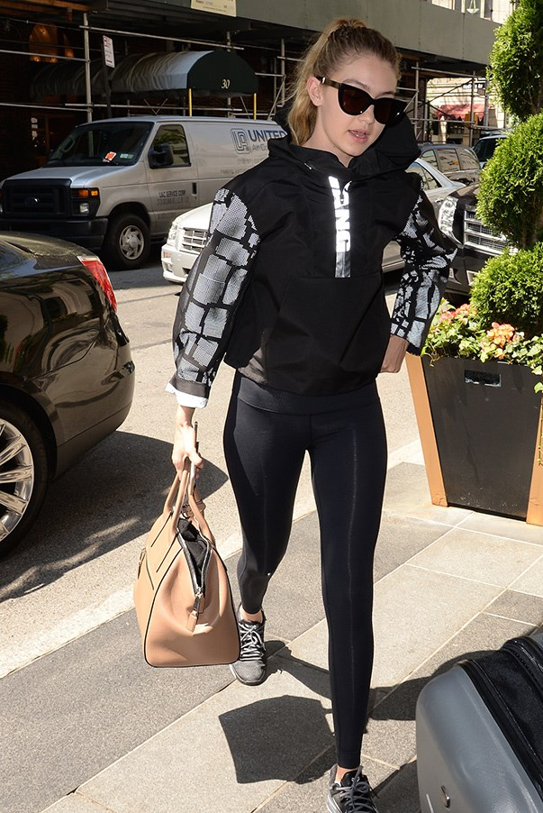 No rest for the wicked, Gigi hits the gym the day after the <strong>Met Ball</strong> in an (mostly) all black ensemble -  the graphic python print on her Alexander Wang bomber jacket adding the perfect sartorial touch to a comfortable and casual outfit.