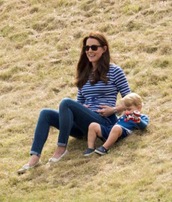 Kate proves she's not to prim to roll on the grass with Prince George.