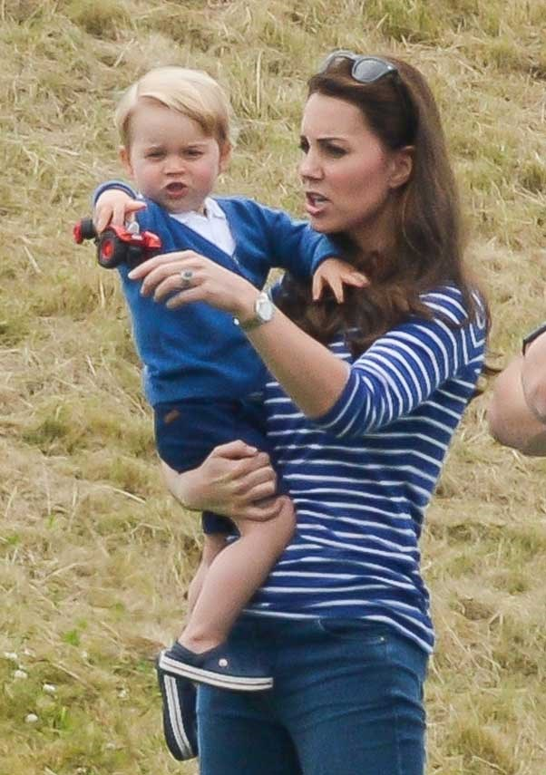 Kate points out the ponies to Prince George at the Gigaset Charity Polo match in Tetbury.