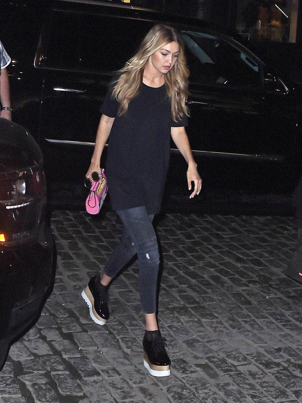 Upgrading the tee and jean combo with a killer pair of flatforms while having dinner with Taylor Swift and Martha Hunt.