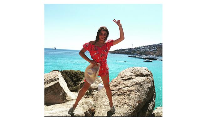 <b>Bambi Northwood Blyth</b> <br> @bambilegit rocking peace signs and a floral play-suit on her island holiday.