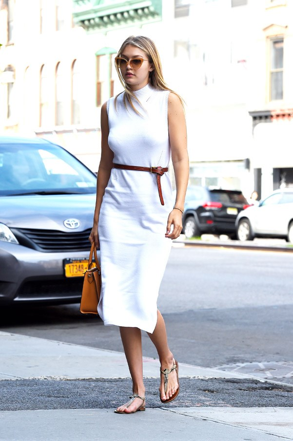 Tube dress, neutral accessories. Gigi channels her inner uptown girl in downtown Soho.
