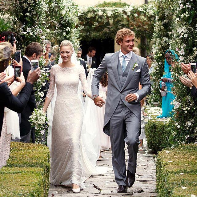 Following their civil wedding last week in Monaco, Beatrice Borromeo wed her handsome beau Pierre Casiraghi in a religious ceremony this weekend on her family's private island in Northern Italy. The bride wore a custom-made ivory Giorgio Armani Privé gown and a beautiful train.