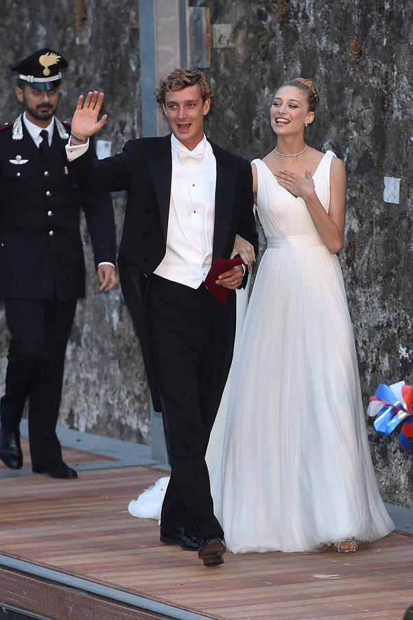 The happy couple make their way to their white tie reception.