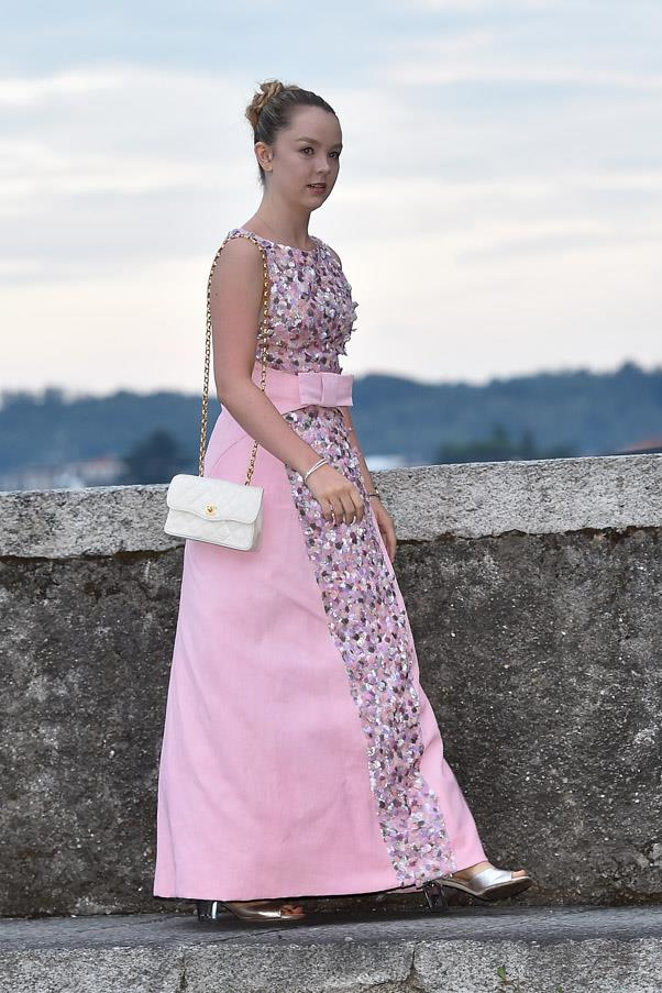 Princess Alexandra of Hanover attends the wedding reception in a pink ballgown. She is the only child of Princess Caroline of Monaco and Prince Ernst August, heir to the throne of the defunct Kingdom of Hanover.