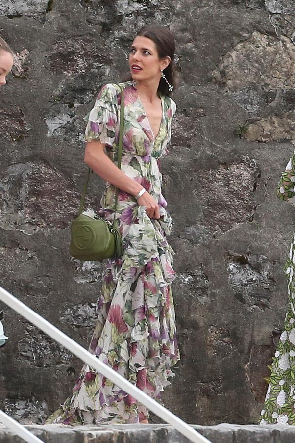 The groom's sister Charlotte Casiraghi, Gucci face and granddaugther to Grace Kelly, wore a stunning floral gown to the nuptials - paired with a Gucci bag, of course.