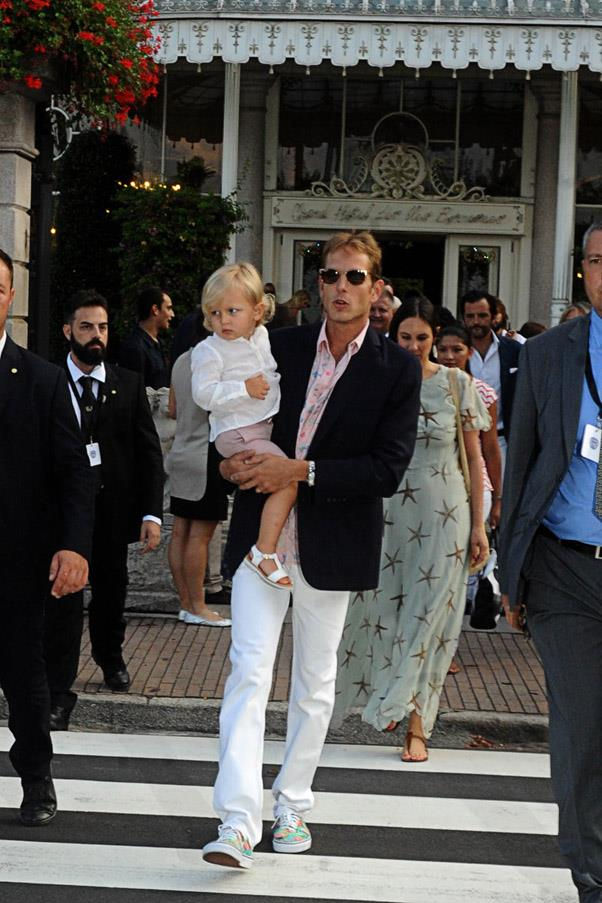 The groom's brother Andrea Casiraghi carries his son Sacha to a pre-wedding celebration.
