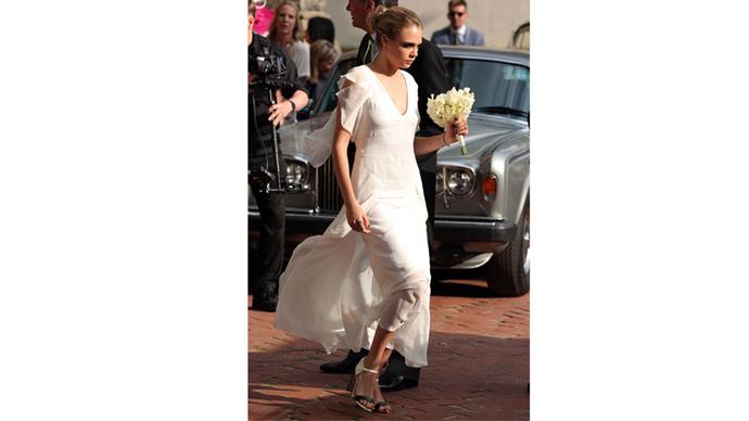 <strong>Cara Delevingne</strong><br><br> The supermodel played bridesmaid for sister Poppy's two (!!) weddings.