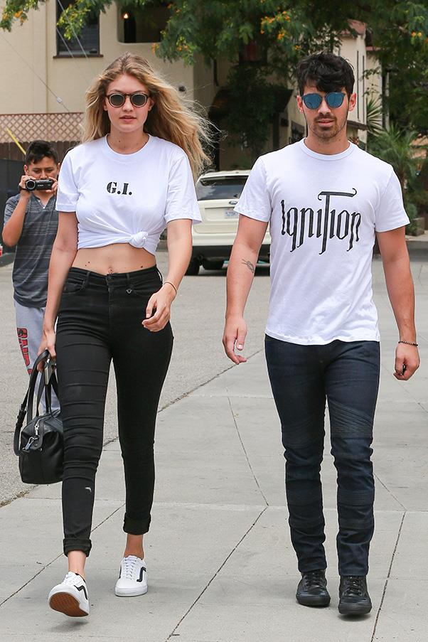Is this the easiest way ever to sex up a jeans-tee-and-sneaker combo? Hadid steps out with beau Joe Jonas in a knotted tshirt that shows just the right amount of skin.