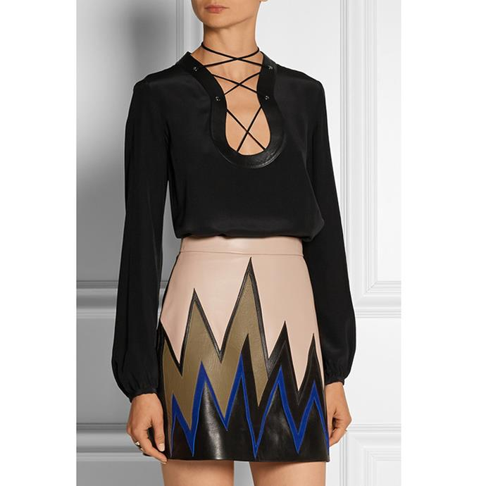 "Emilio Pucci lace-up top, $1,263.86 <br><a href=""http://www.net-a-porter.com/product/591534/Emilio_Pucci/lace-up-leather-trimmed-silk-crepe-de-chine-top"">Net-A-Porter.com </a>"