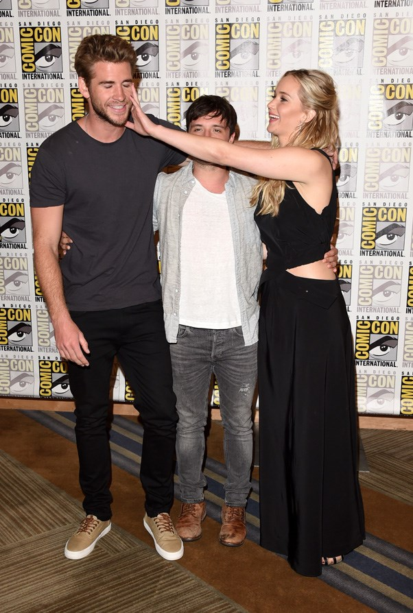 "Having fun with ""The Hunger Games: Mockingjay - Part 2"" co-stars Liam Hemsworth and Josh Hutcherson."